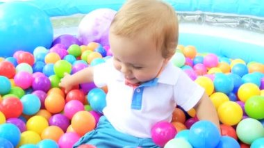 Laughing Little Boy Playing in Plastic Ball Pool — Stock Video