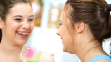Caucasian girls drinking nutritious blended fruit vegetable drink — Stock Video