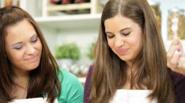 Teenage Caucasian Girls Tasting Cake Baking Mix — Vídeo de Stock