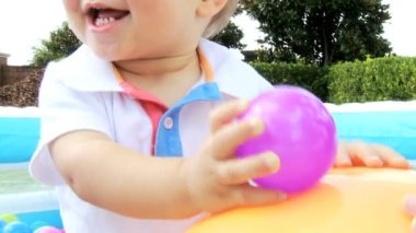 Caucasian Child Playing Ball  at Pool — Stock Video