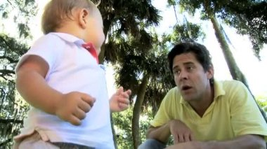 Young Father Playing with  Cute Little Caucasian Son at  Park — Stock Video