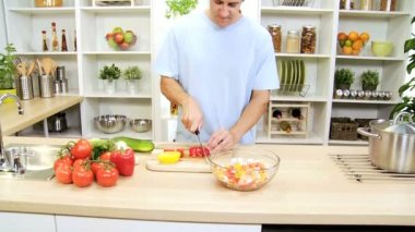 Healthy Caucasian Man Slicing Fresh Vegetables — Stock Video