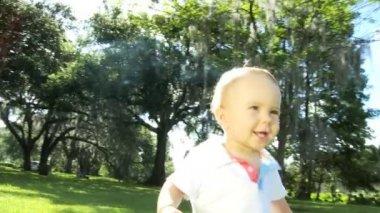 Caucasian toddler child slowly walking barefoot — Stock Video