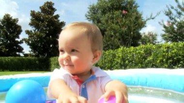 Caucasian baby boy enjoying himself playing at  plastic ball pool — Stock Video