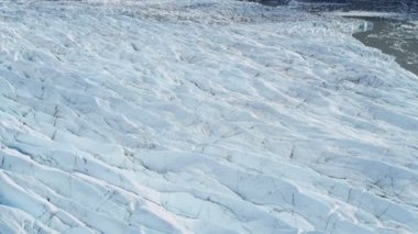 Aerial view ice glacier constantly moving under its own gravity, Arctic Region — Vidéo