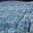 Aerial view of blackened ice glacier by dirt and debris constantly moving due to Global warming, Arctic Region, Northern Hemisphere shot on RED EPIC — Stock Video #49590553