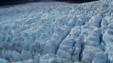 Aerial view of  blackened ice glacier by dirt and debris constantly moving due to Global warming, Arctic Region, Northern Hemisphere shot on RED EPIC — Wideo stockowe