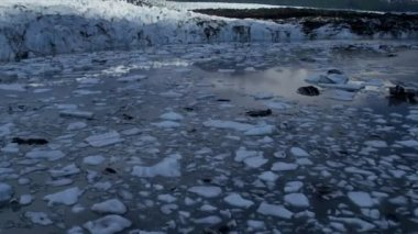 Aerial view of melting ice flows broken from Knik Glacier face due to warming environment, South central Alaska, USA shot on RED EPIC — Vidéo