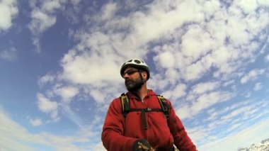 Peak Climber filming the mountain landscape with  snow caped Peaks — Stock Video