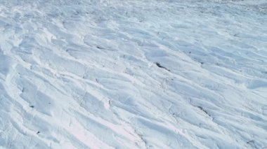 Aerial view ice glacier constantly moving under its own gravity, Arctic Region — Stok video