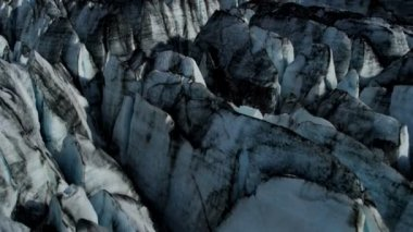 Aerial view of moraine blackened ice glacier constantly moving due to Global warming, Arctic Region, Northern Hemisphere shot on RED EPIC — Wideo stockowe
