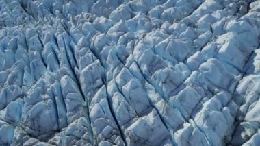 Aerial view of blue Ice Glacier constantly moving with crevasses scared with moraine, Arctic Region  Northern Hemisphere shot on RED EPIC — 图库视频影像