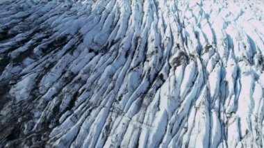 Aerial view of moraine covered Ice Glacier, Arctic Region — Стоковое видео