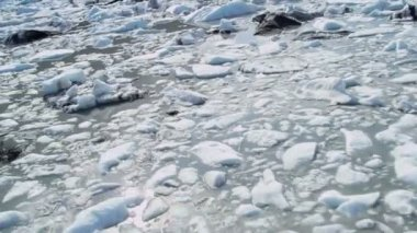 Aerial view broken off ice flows dirt and debris — Stock Video