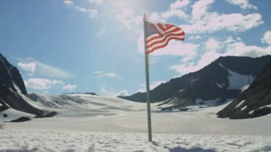 USA flag in Arctic Circle remote wilderness — Стоковое видео