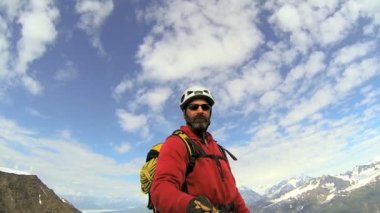 Peak Climber selfie filming the panorama mountain landscape with snow caped Peaks — Stock Video