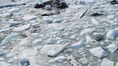 Aerial view broken off ice flows dirt and debris — Wideo stockowe
