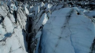 Aerial view of crevasses blackened ice glacier by dirt and debris constantly moving due to Global warming, Arctic Region, Northern Hemisphere shot on RED EPIC — Stockvideo
