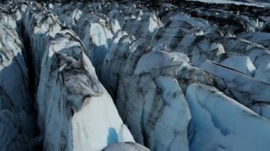 Aerial view of moraine blackened ice glacier crevasses constantly moving due to Global warming, Arctic Region, Northern Hemisphere shot on RED EPIC — Стоковое видео