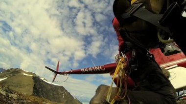 Helicopter dropping off climber — Stock Video