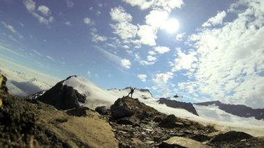 Helicopter and climber in wilderness Alaska — Stockvideo