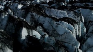 Aerial view of blackened ice glacier by dirt and debris constantly moving due to Global warming, Arctic Region, Northern Hemisphere shot on RED EPIC — Vidéo