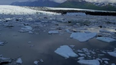 Aerial view ice shelf Knik glacier feeding the Knik River constantly moving under its own gravity Arctic Circle, Alaska, USA shot on RED EPIC — Stock Video
