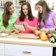Caucasian mother and teenage girls using wireless tablet — Stock Video #49657019