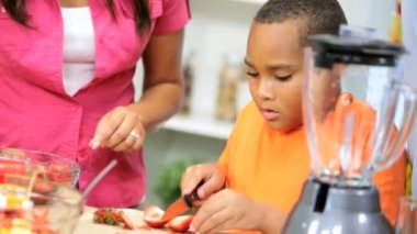 African American Parents Watching Son Prepare Fruit Kitchen — Stock Video