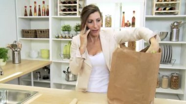 Business Lady talking on  Smart Phone and Unpacking Fruits and  Vegetables — Stock Video