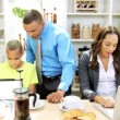 Family in the kitchen preparing with tablet and laptop — Stock Video #49663175