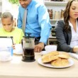 Family in the kitchen preparing with tablet and laptop — Stock Video #49663693