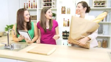 Young Caucasian girl at  home kitchen with  businesswoman mother and sister — Stock Video