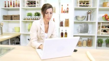 Freelance Caucasian financial advisor working from home with wireless laptop — Stock Video