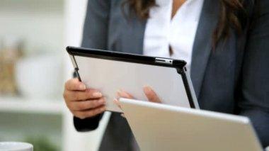 Businesswoman using tablet on Kitchen — Stockvideo