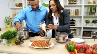 Couple at kitchen using recipe — Vídeo Stock