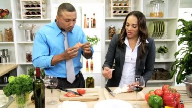 Couple at kitchen slicing vegetables — Stock Video