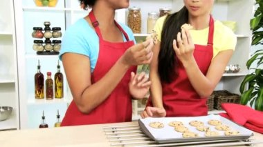 Girlfriends at kitchen eating biscuits — Stock Video