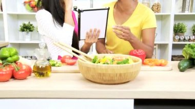 Females holding tablet reading recipe — Stock Video