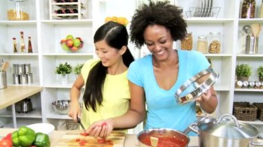 Girlfriends at kitchen cooking vegetables — Stock Video