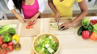 Females preparing salad at kitchen — Stock Video