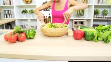 Female at kitchen mixing ingredients — Stock Video