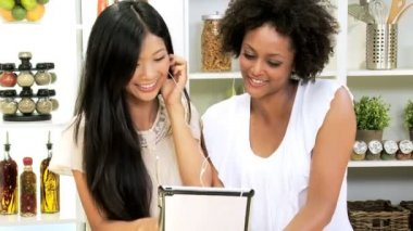 Girlfriends listening music on tablet — Stock Video