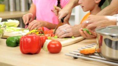Children helping dad prepare dinner — Stock Video