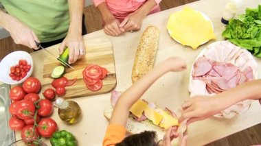 Parents and children filling baguettes — Stock Video