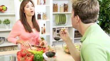 Couple at kitchen preparing dinner — Stock Video