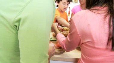 Family preparing healthy crusty baguette — Stock Video