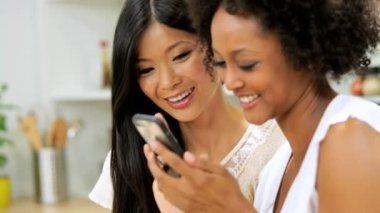 Girlfriends using speaker on smartphone — Stock Video