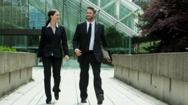 Business people walking outdoors — Stock Video