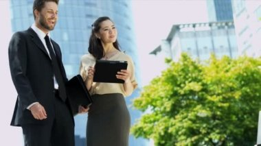 Business people with tablet meet a businesswoman — Stock video